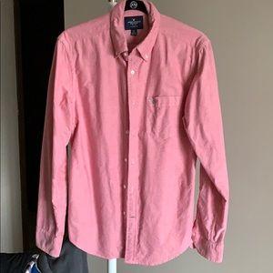 A salmon color American eagle dress shirt